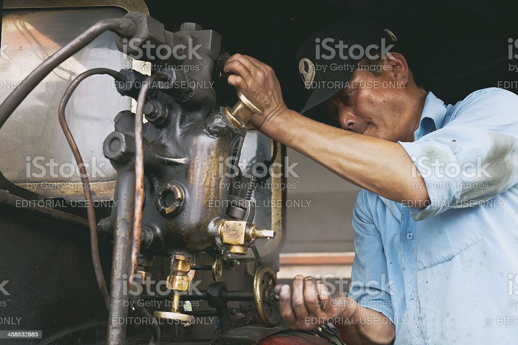 Steam Engine Driver on Old Toy Train in Darjeeling, India royalty-free stock photo