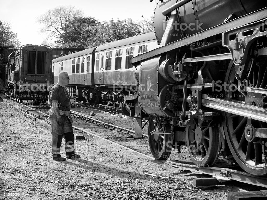 Steam engine transferring to the railway track stock photo