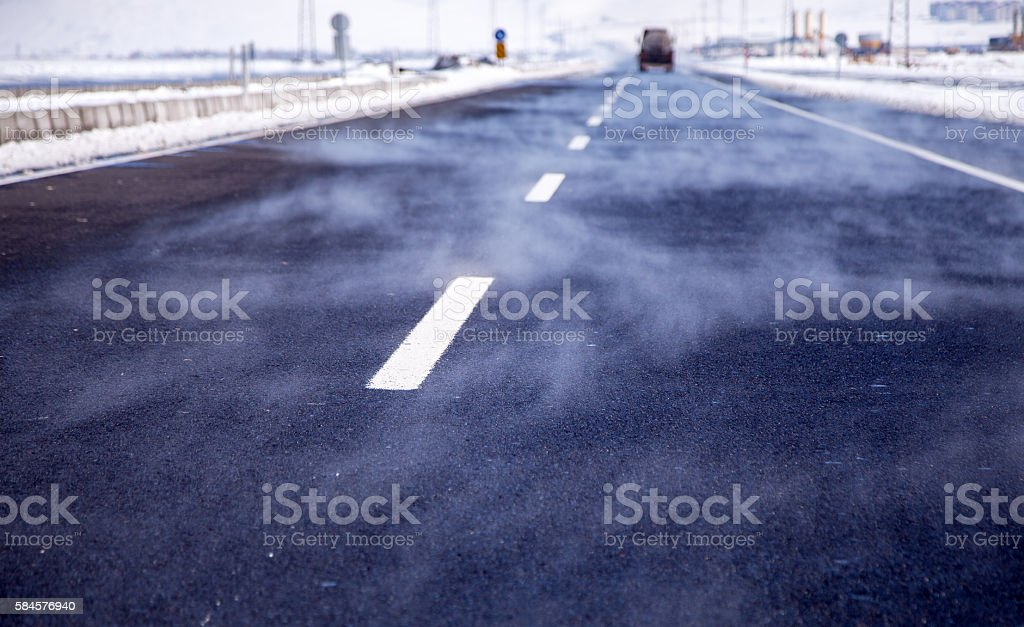 Steam from asphalt stock photo