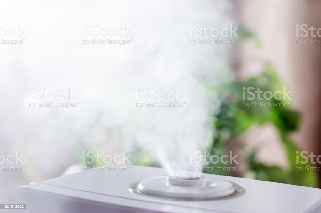 Steam humidifier in the house stock photo