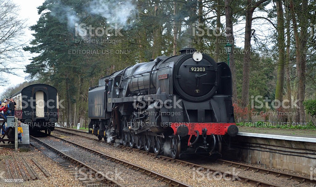 Steam locomotive 92203 Black Prince at  Holt station stock photo