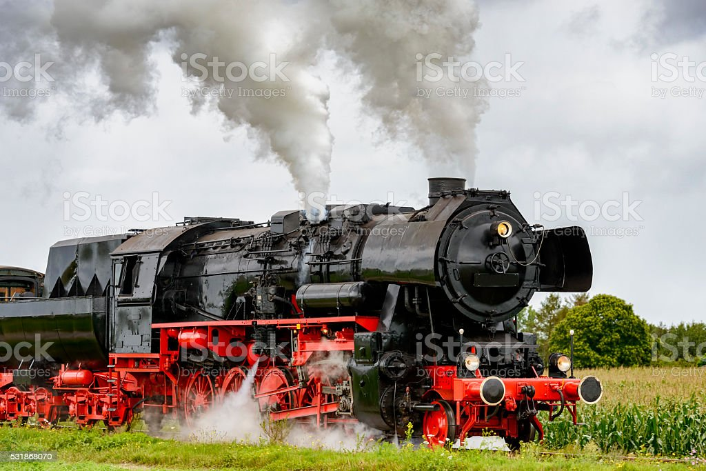 Steam locomotive in the country stock photo