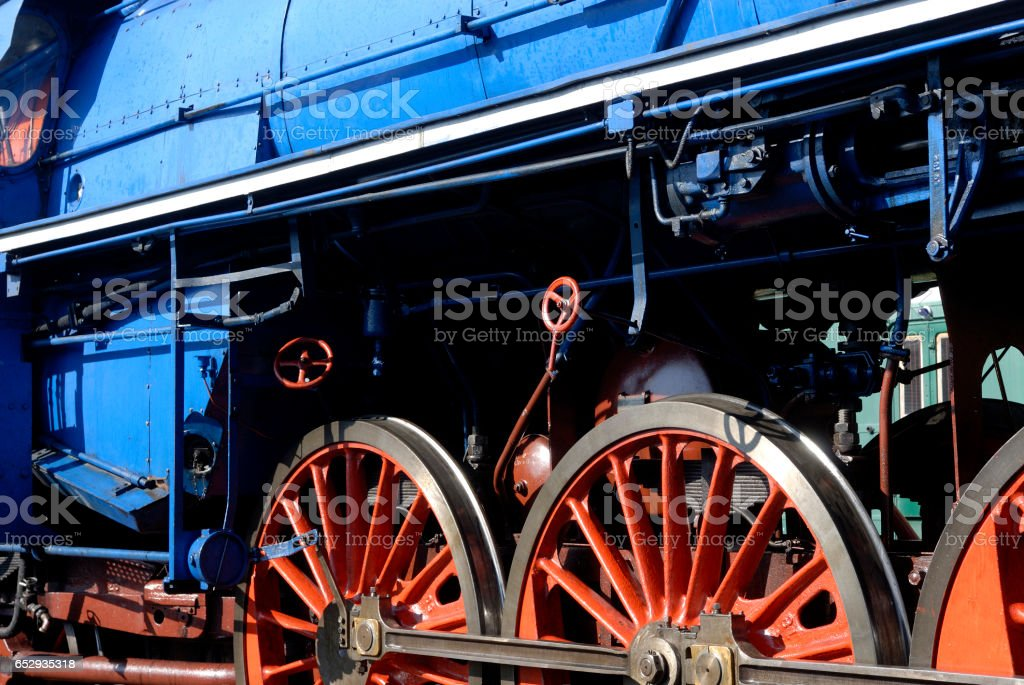 Steam locomotive wheels and rods closeup. stock photo
