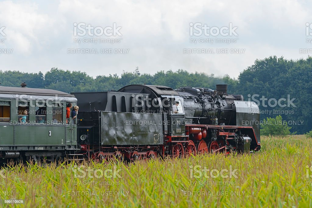 Steam locomotive with passenger railway cars stock photo