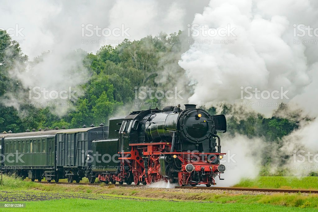 Steam Locomotive with railway cars in the country stock photo