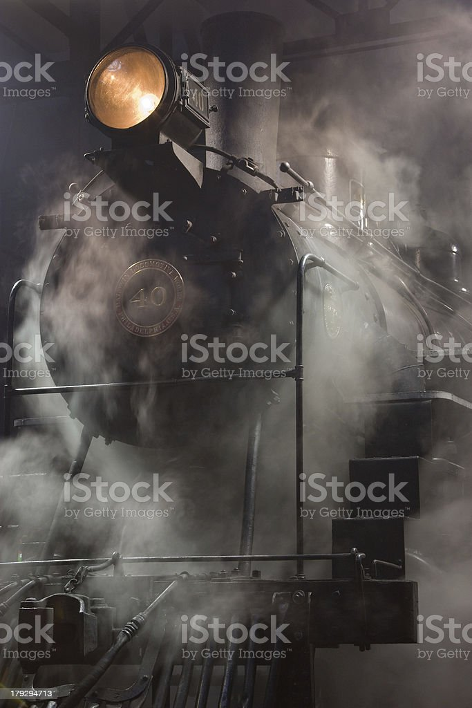 Steam Locomotive wreathed in condensation stock photo