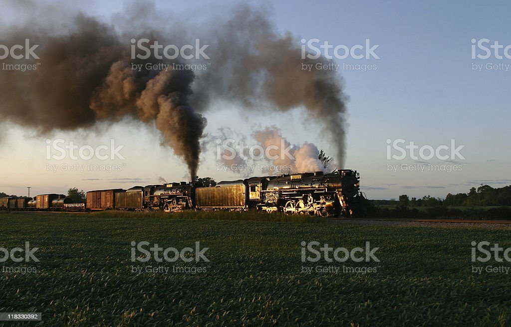 Steam Locomotives at Sunset royalty-free stock photo