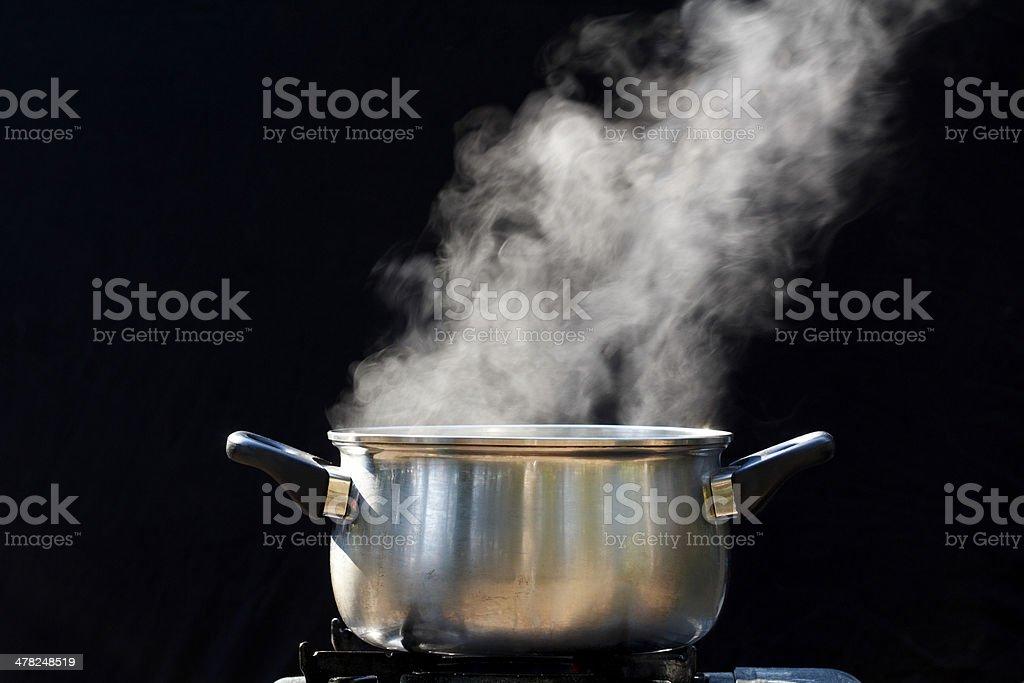 steam on pot in kitchen stock photo