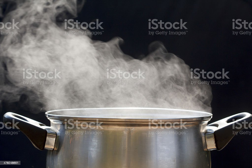 steam on pot in kitchen stock photo