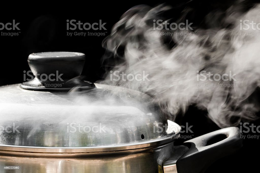 steam over cooking pot stock photo