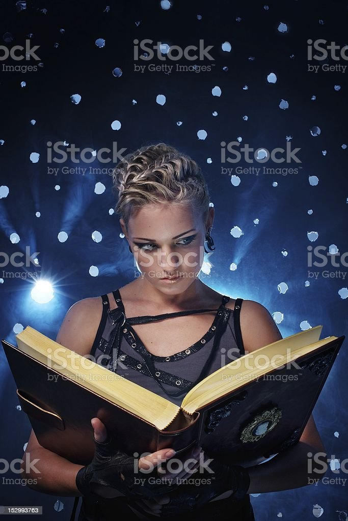 Steam punk girl with a book royalty-free stock photo
