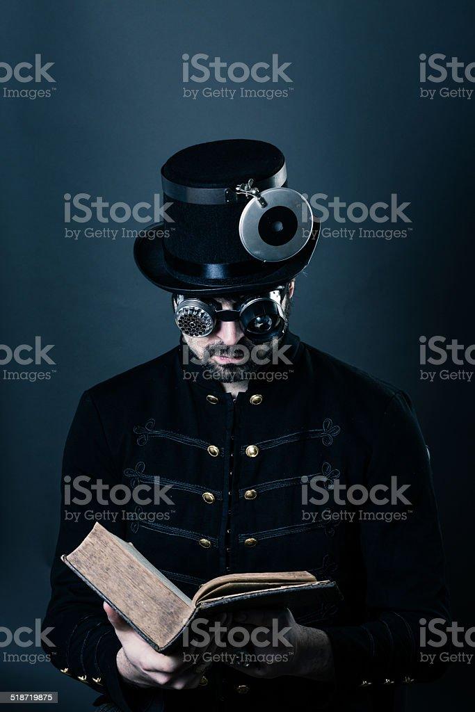 steam punk man reading stock photo