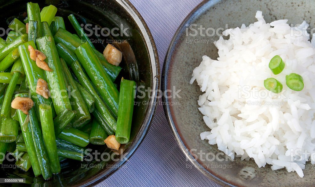 Steam rice with fried spring onion with oyster sauce royalty-free stock photo