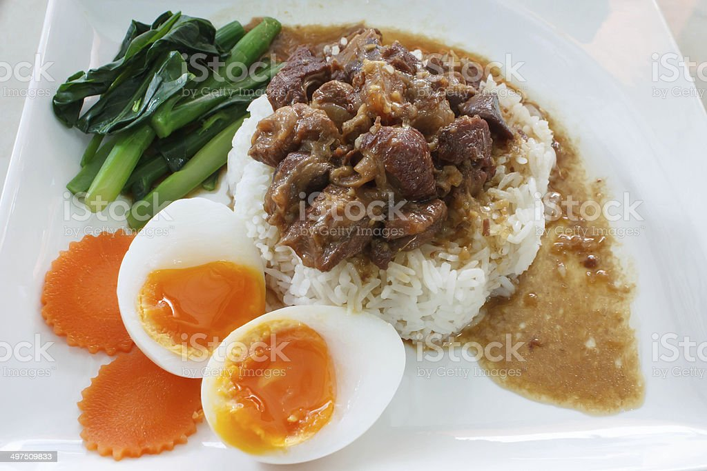 Steam rice with Thai style braised pork and Soft-boiled eggs. stock photo
