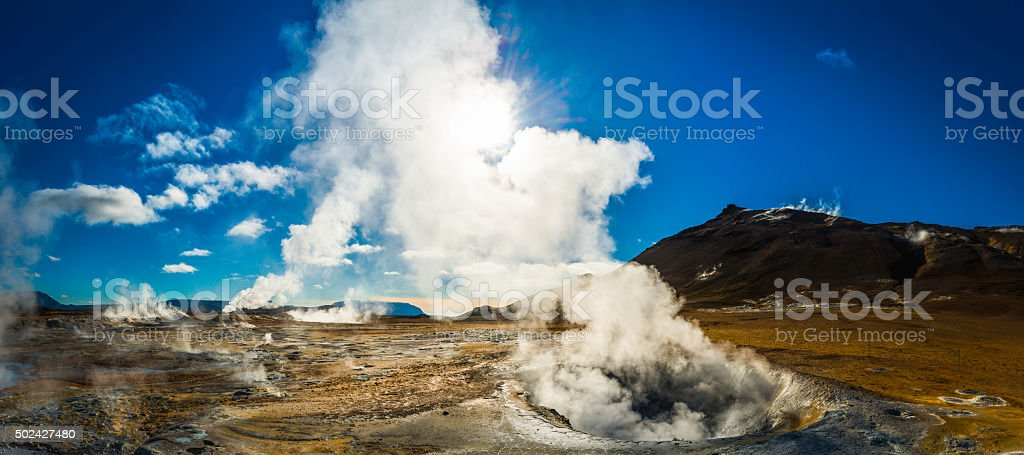 Steam rising from geyser fumarole volcanic lava field panorama Iceland stock photo