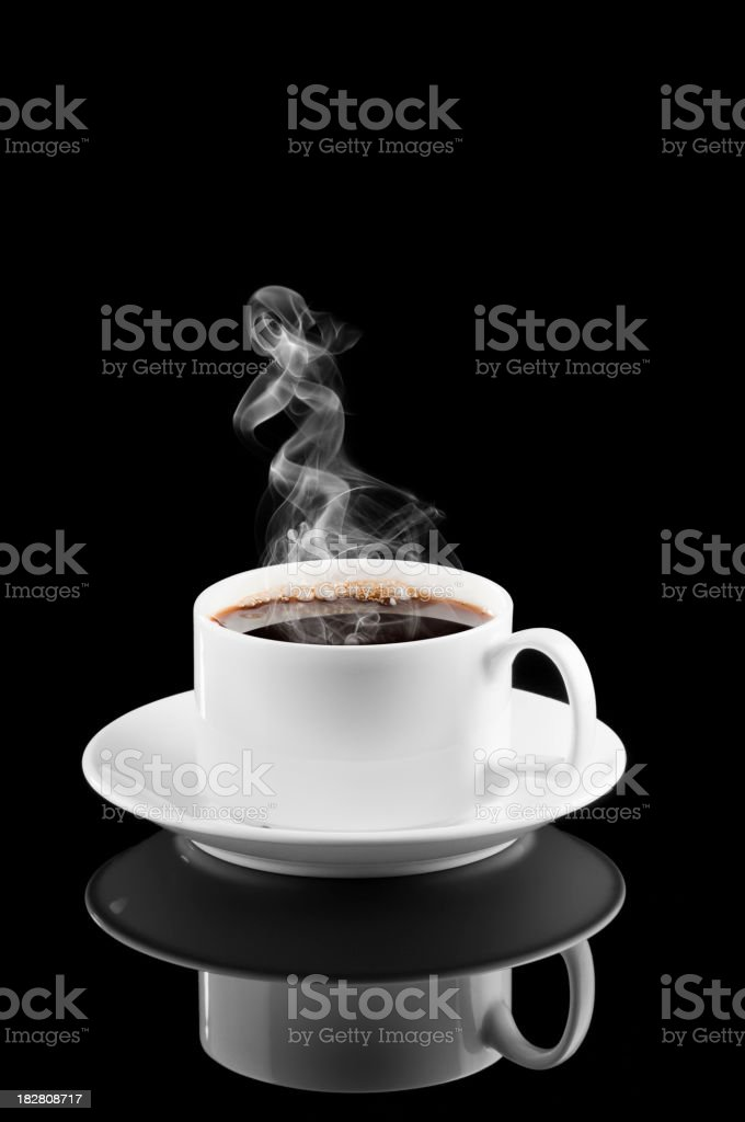 Steam rising from hot coffee in white cup and saucer royalty-free stock photo