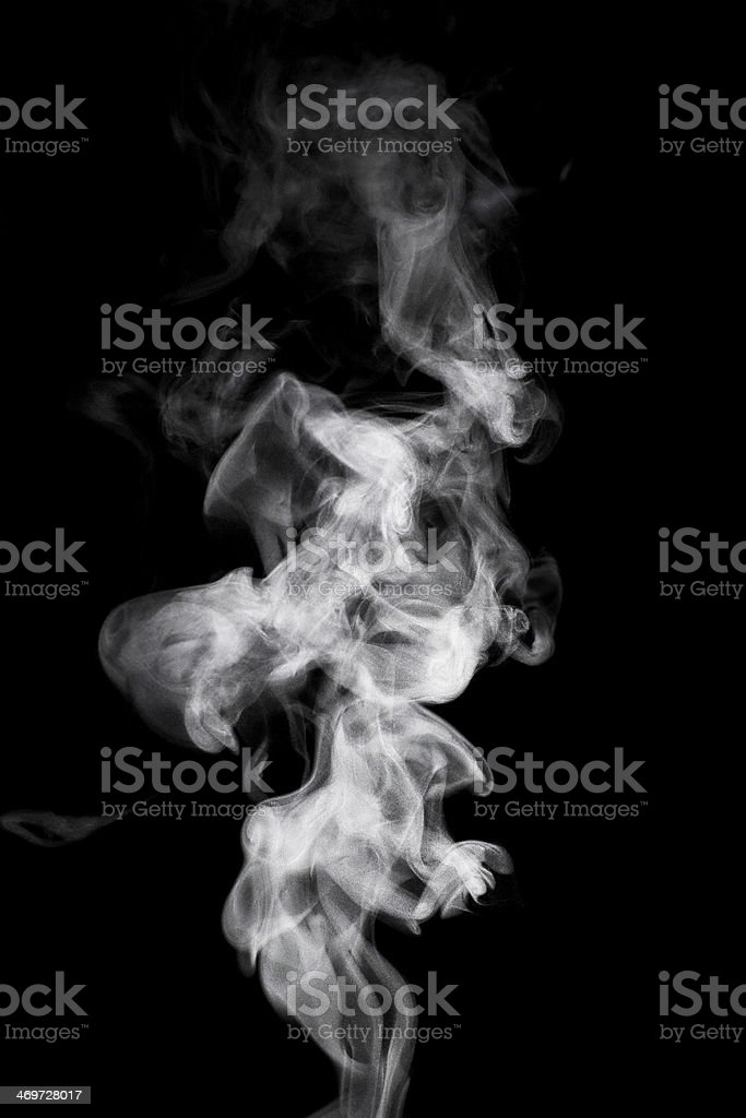 Steam rising in front of a black background stock photo