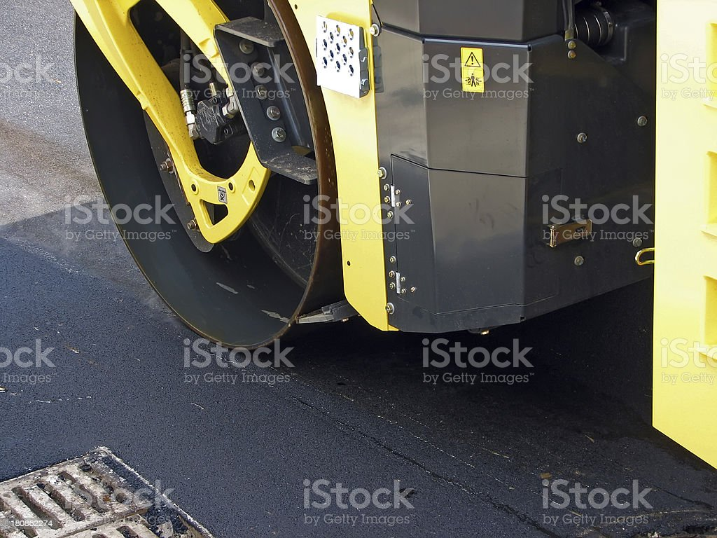 Steam roller machine.