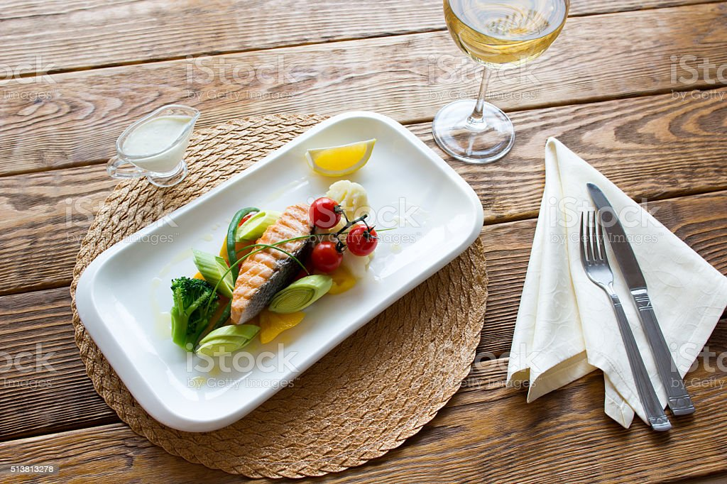 Steam salmon with side dish of vegetables stock photo