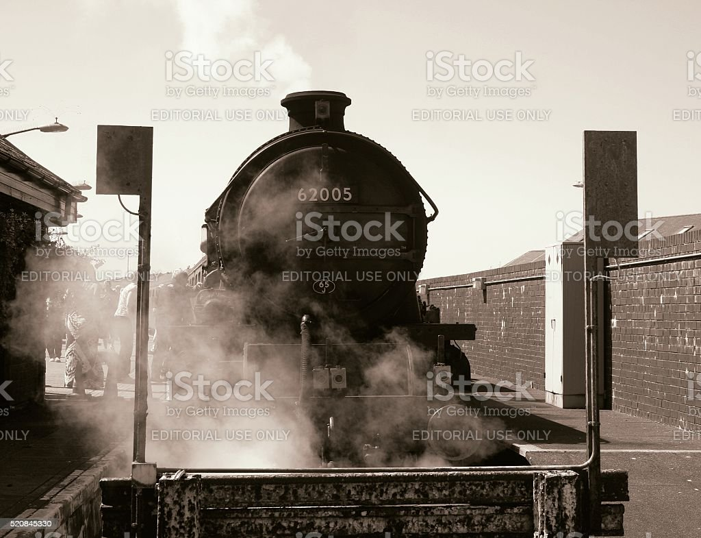 Steam Train at station. Vintage locomotive. stock photo