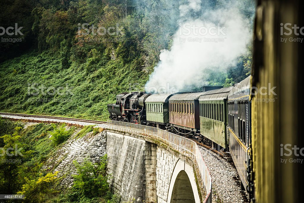 Steam train composition on railway journey stock photo