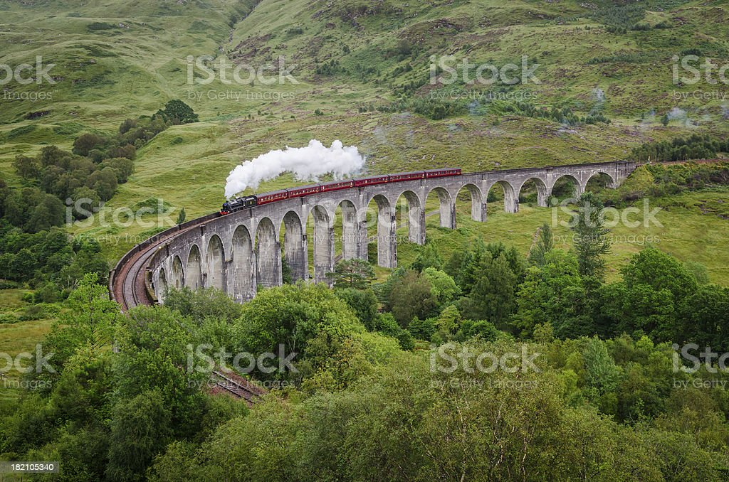 Steam train on a famous Glenfinnan viaduct, Scotland stock photo