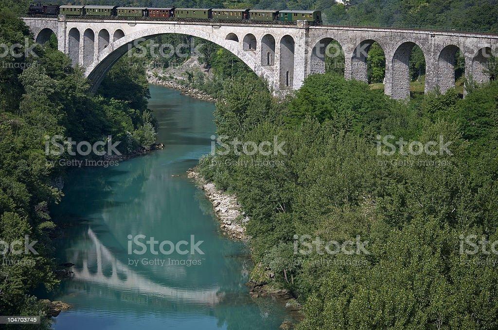 Steam Train on Stone Bridge Slovenia royalty-free stock photo
