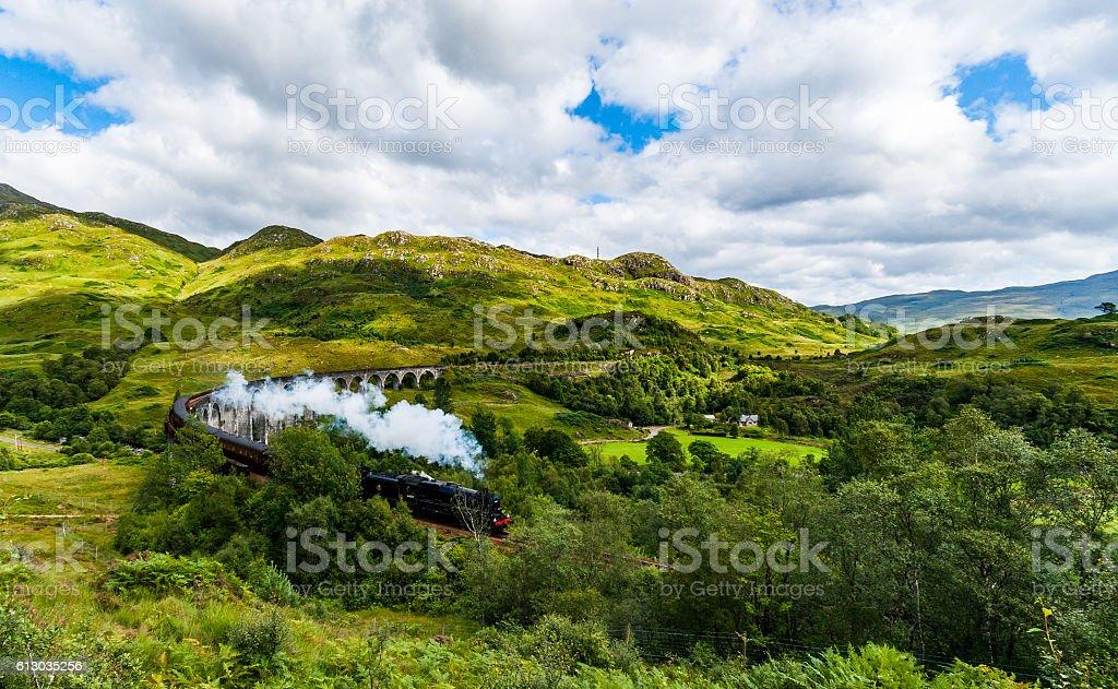 Steam Train on Viaduct stock photo