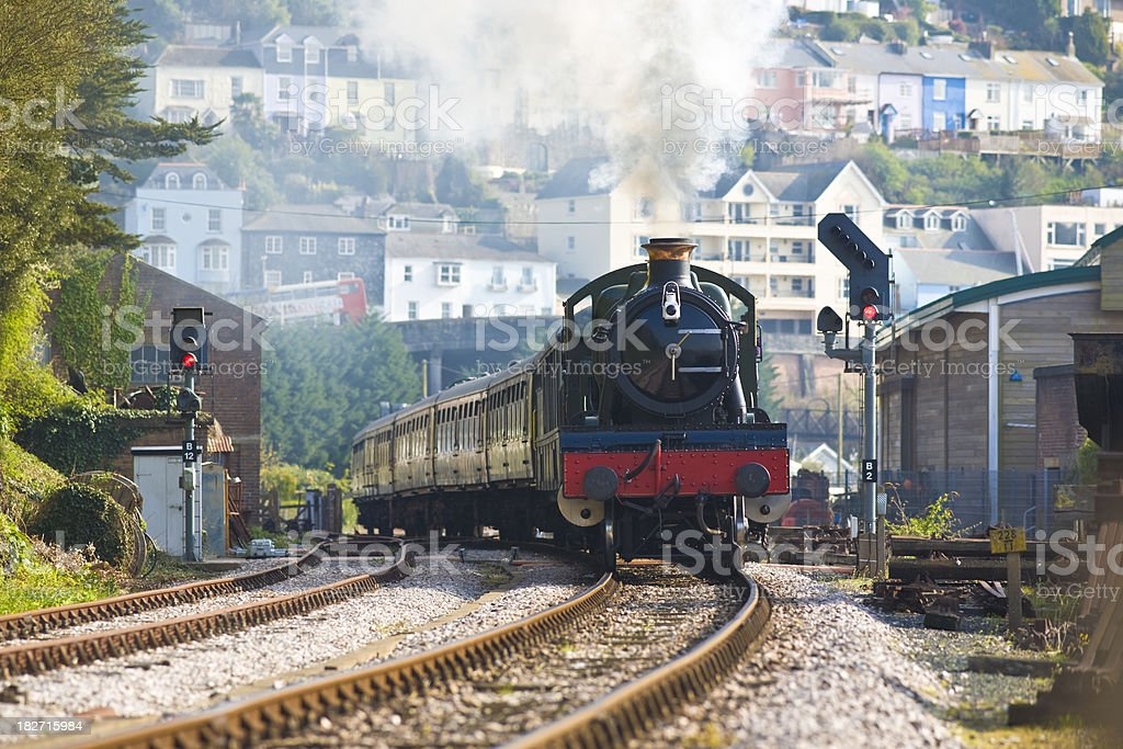 Steam train with smoke in an English town stock photo
