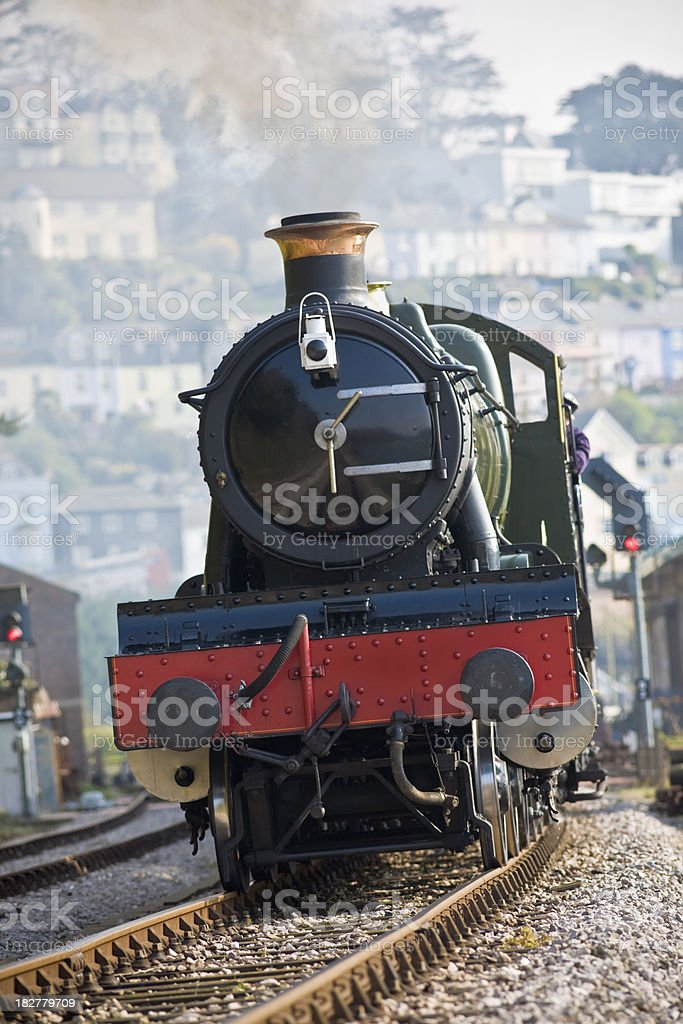 Steam train with smoke in an English town vertical stock photo