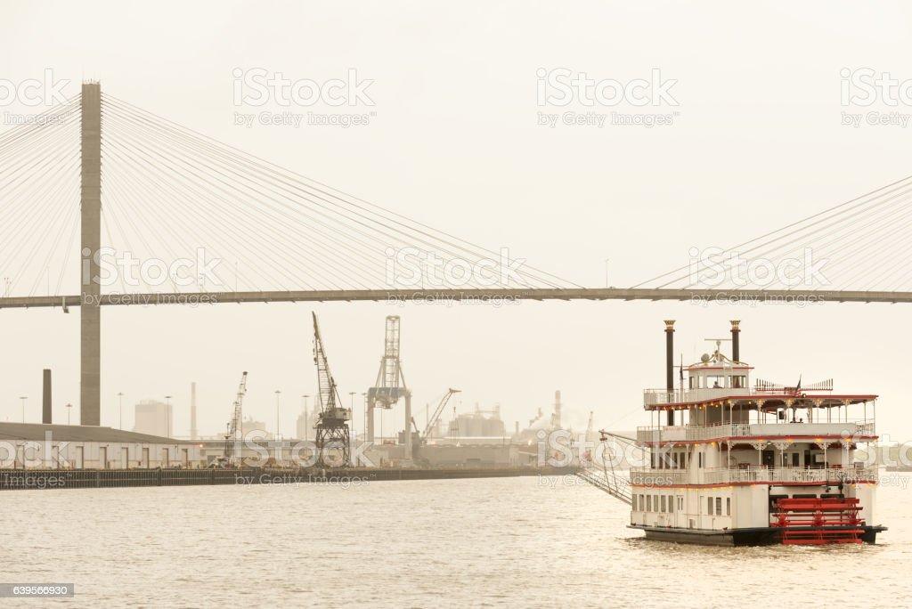 Steamboat on Savannah river and Talmadge bridge stock photo