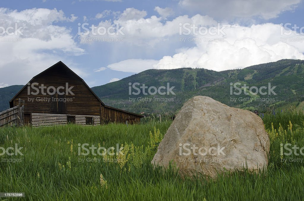 Steamboat Springs Barn and Ski Slopes in Summer royalty-free stock photo