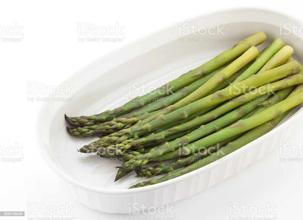 Steamed asparagus spears on white plate stock photo