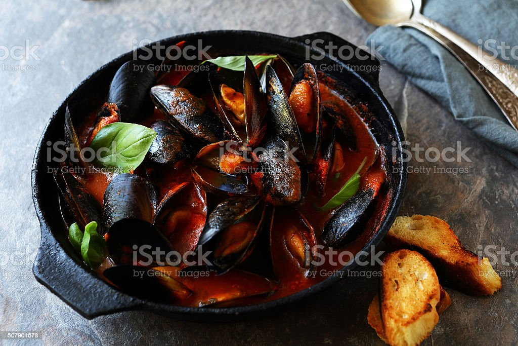 steamed black mussels in pan stock photo