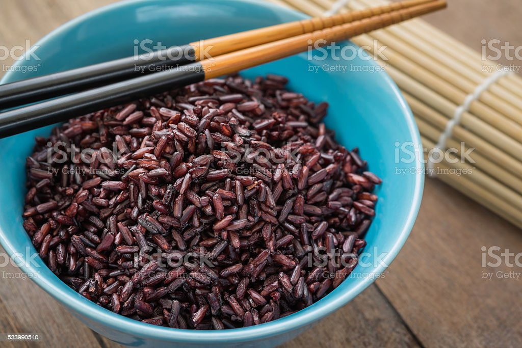 Steamed black rice in bowl stock photo