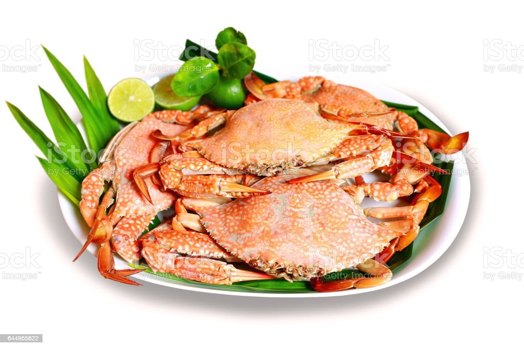 Steamed Blue swimming crabs or flower crabs on white background. stock photo