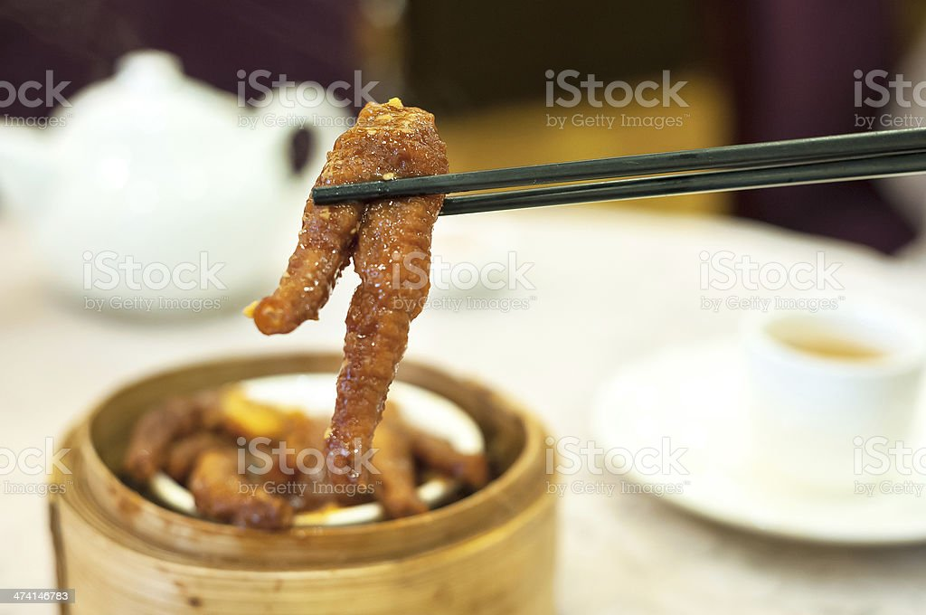 Steamed chicken feet in black bean sauce stock photo