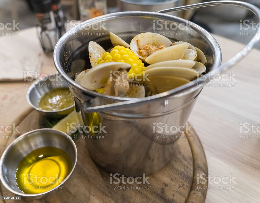 Steamed Clam in Metal Bucket stock photo