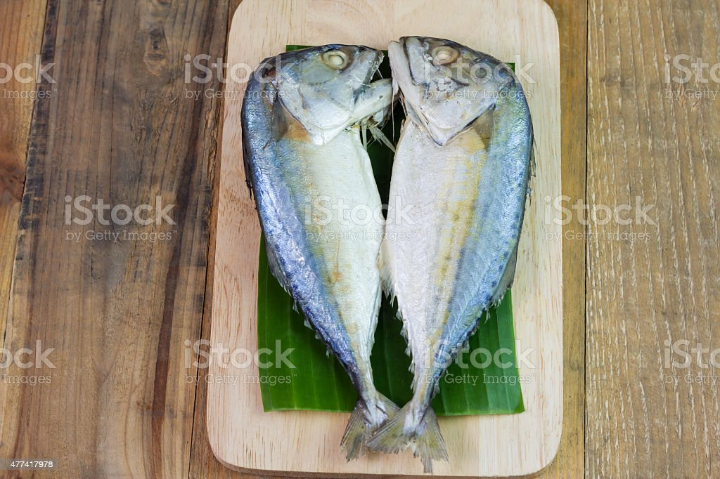 Steamed mackerel or tuna steamed on wooden background royalty-free stock photo