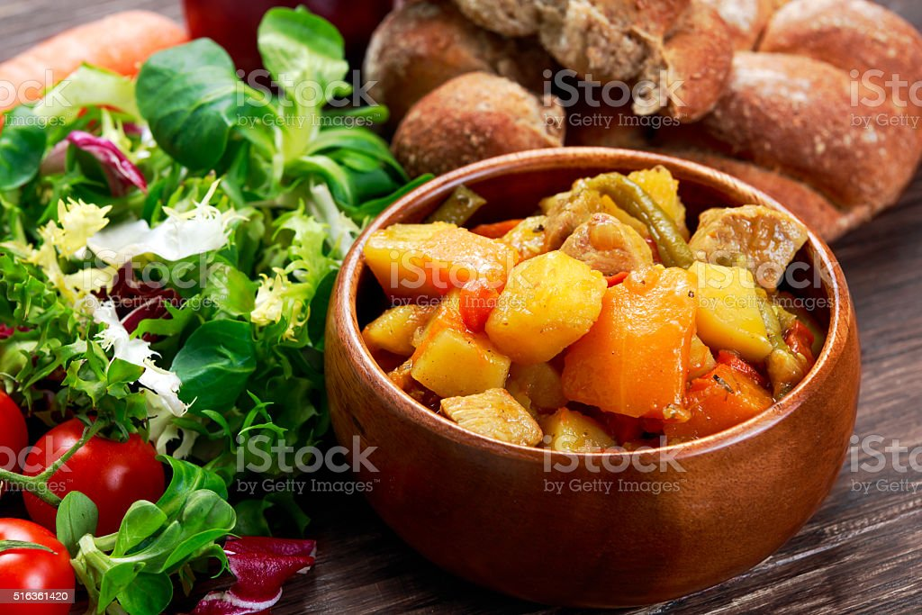 steamed mix of vegetables with meat and green beans stock photo