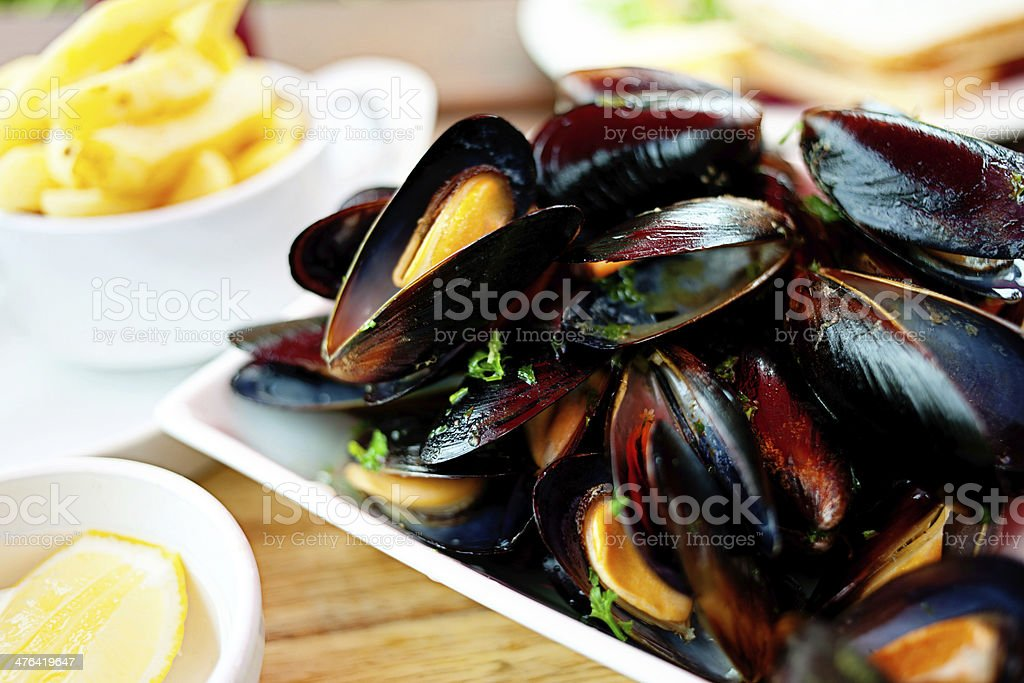 Steamed Mussels with Chips stock photo