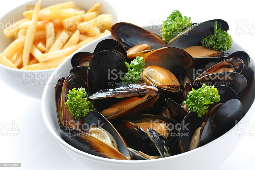 steamed mussels with white wine, french fries stock photo
