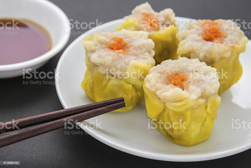 Steamed pork dumpling and soy sauce, Chinese food stock photo