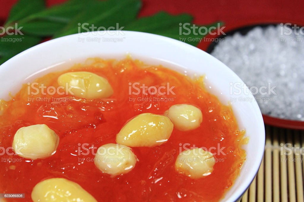 Steamed Red Bird Nest and ginkgo seed in ceramic cup stock photo