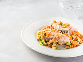 Steamed salmon with carrots and zucchini