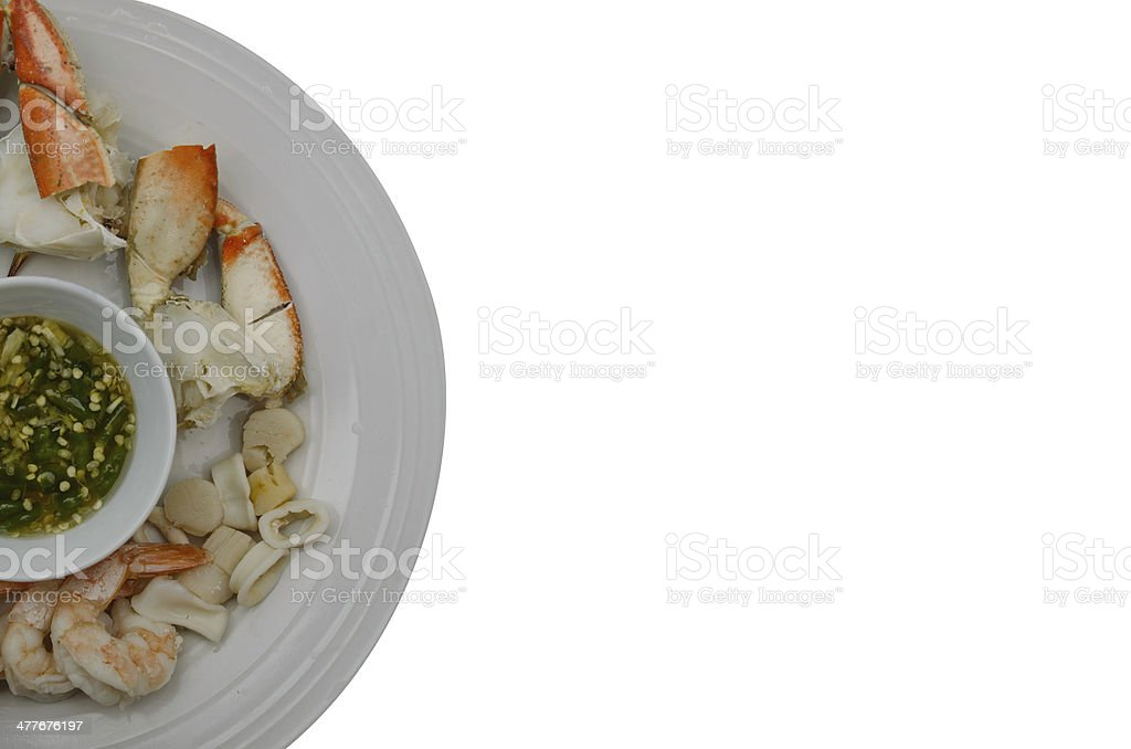 Steamed seafood with spicy dipping sauce on dish stock photo
