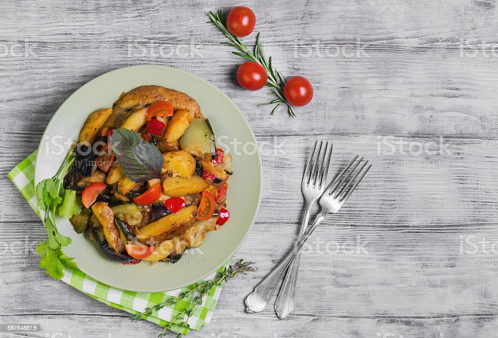 Steamed vegetables with rustic roasted potatoes stock photo