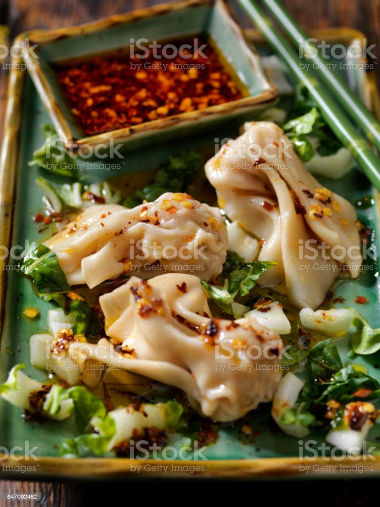 Steamed Wontons With Bok Choy and Chili oil stock photo
