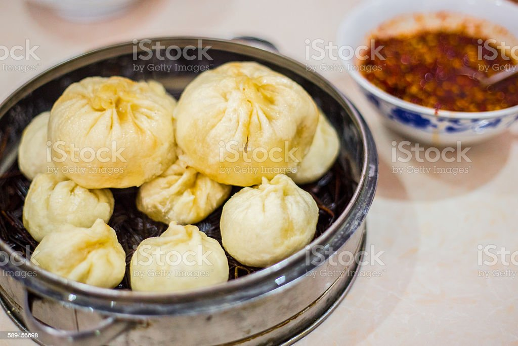 Steamer with differently sized Chinese baozi stock photo