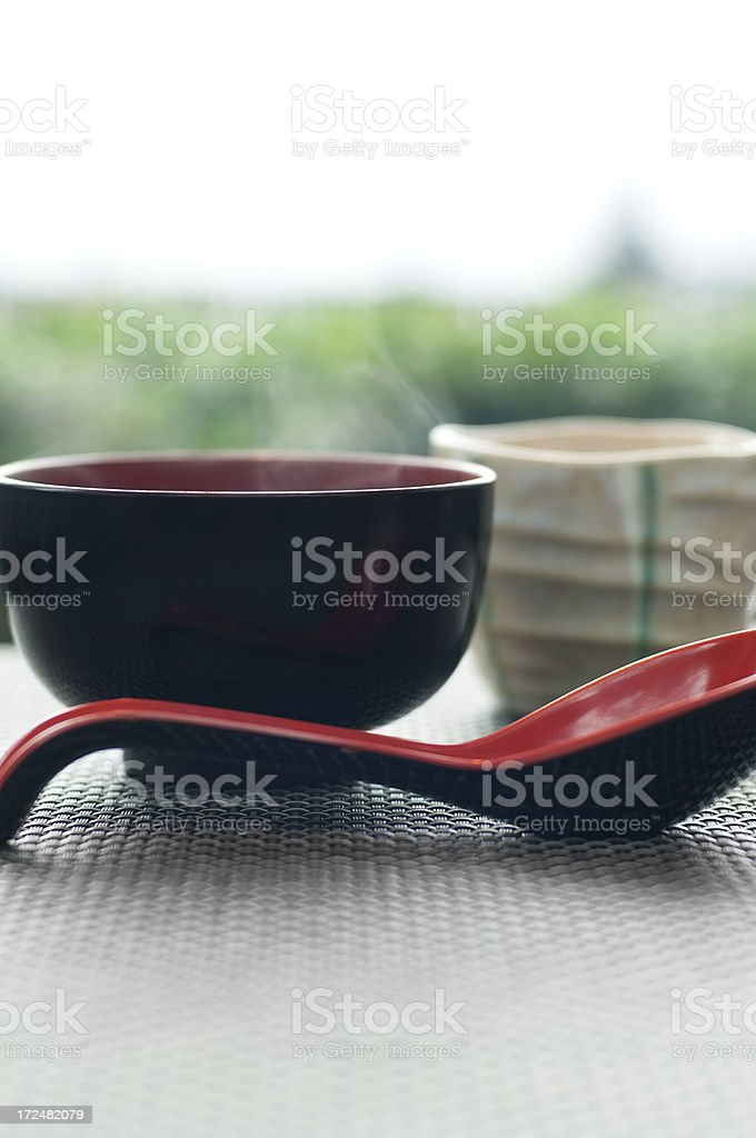 Steaming Asian Soup and Tea stock photo